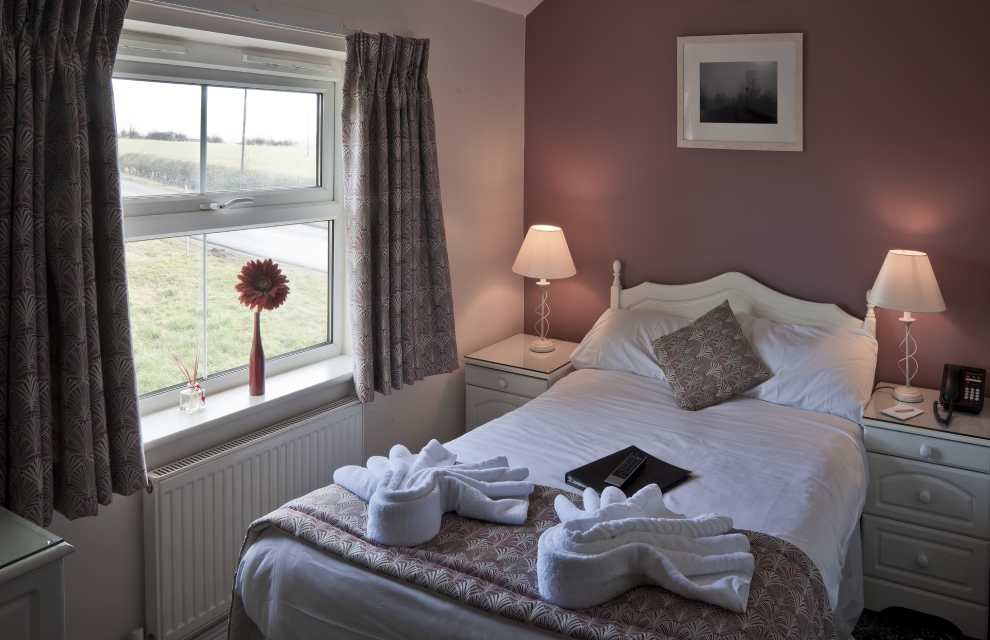 Bedroom with towles on the bed